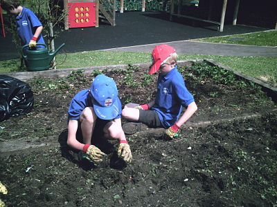 Kimpton Primary School students potting plants